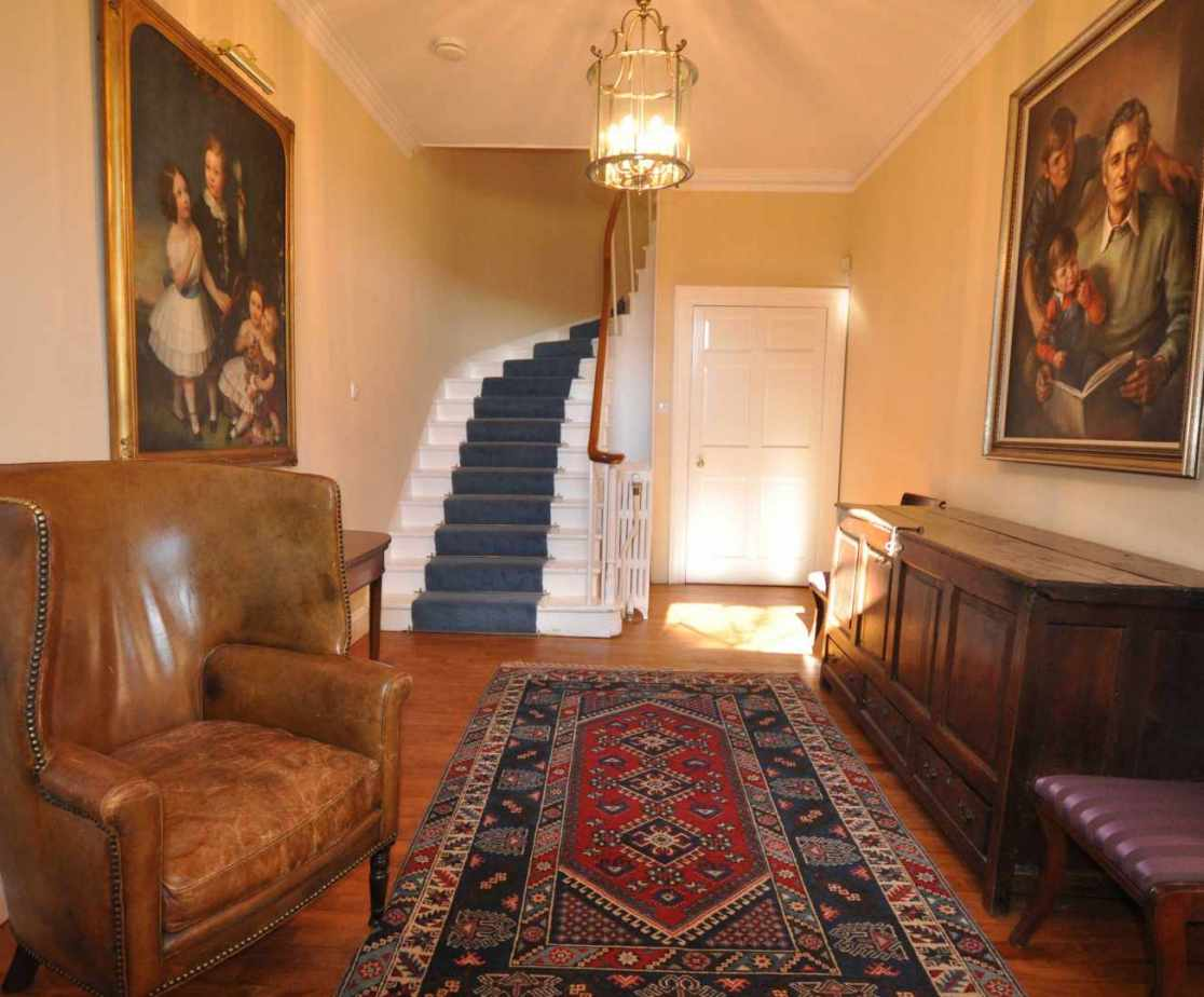 Through the front door you'll walk into a smart entrance hall with wood polished floors