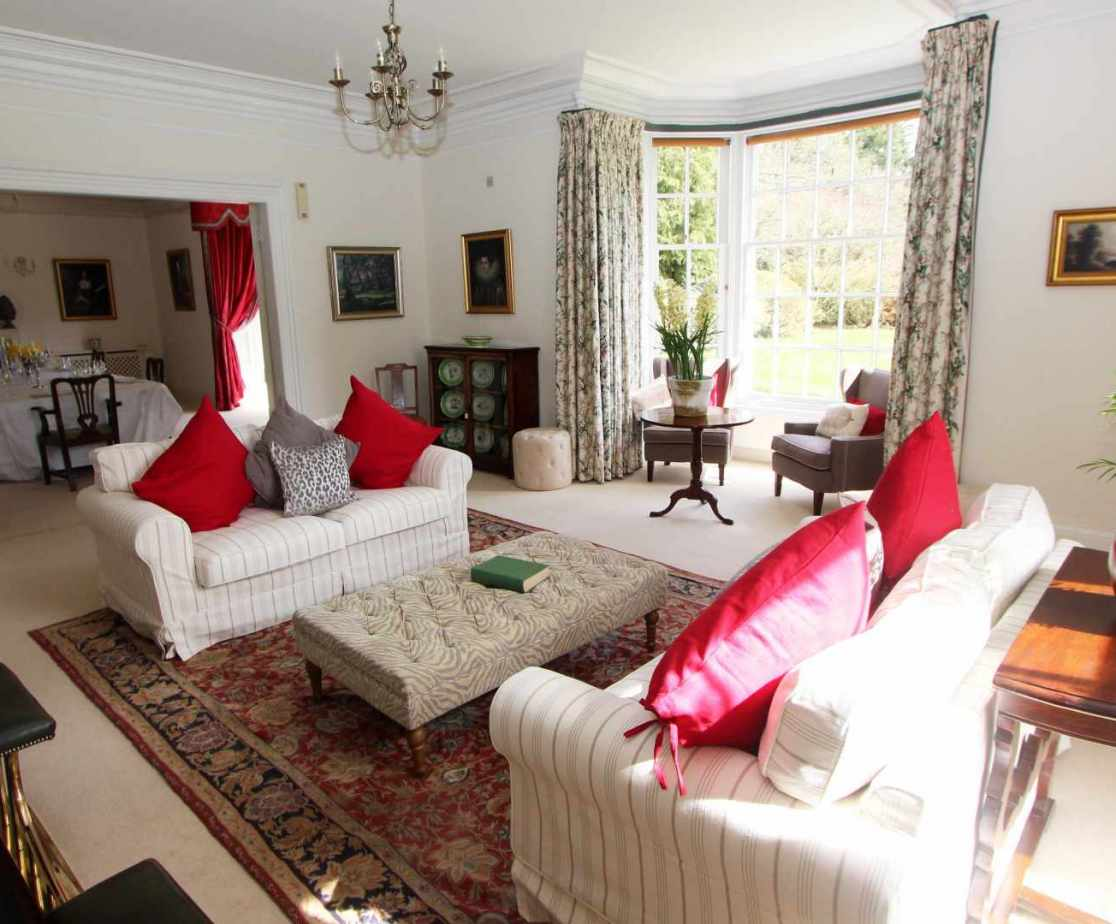 The large windows in the drawing room allow the light to flood in