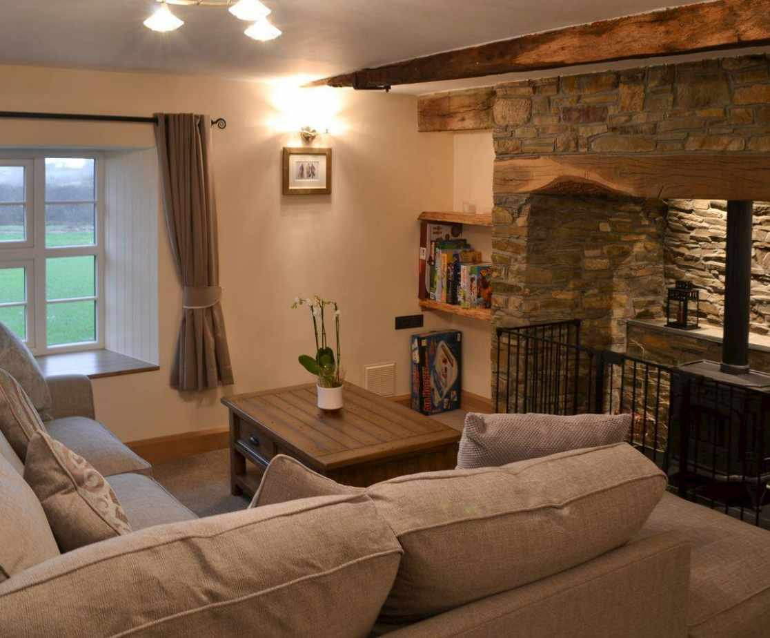 Cosy living space with Inglenook fireplace & gas wood burner